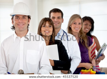 Group of happy people with different professions indoors - stock photo