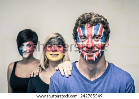 Group of happy people with painted European flags on their faces. - stock photo