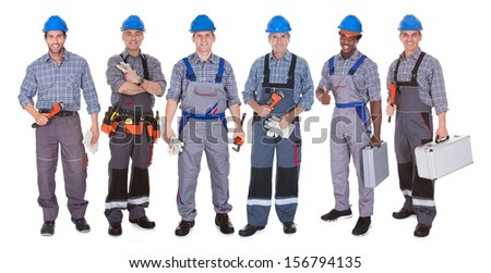 Group Of Happy Plumber Holding Tools Over White Background - stock photo