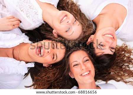 Group of happy pretty laughing girls