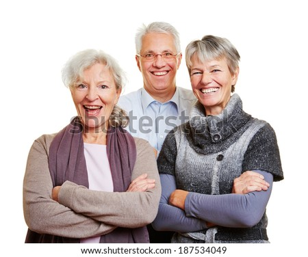 Group of happy senior people smiling with their arms crossed - stock photo
