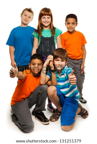 Group of happy smiling kids standing together and playing - boys and girls black and Caucasian, isolated on white - stock photo