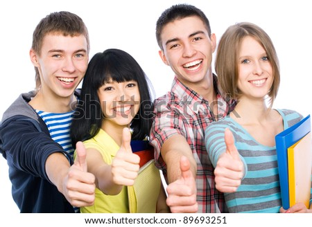Group of happy students giving the thumbs-up sign