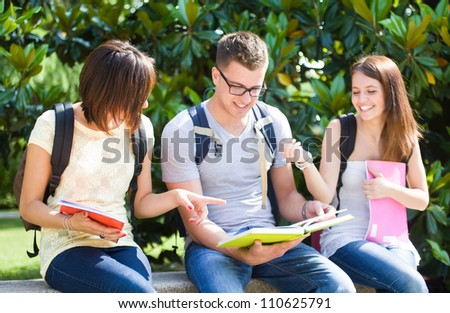 Group of happy students in a park - stock photo