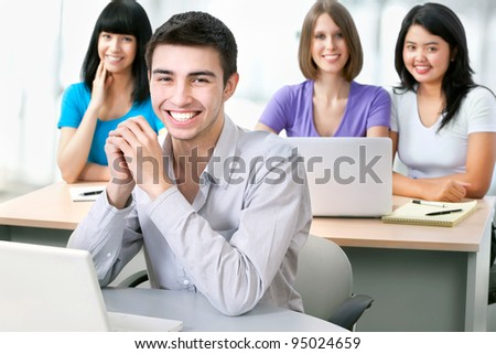 Group of happy students look at the camera - stock photo