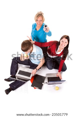 Group of happy students with the laptops and web cam (isolated on white) - stock photo