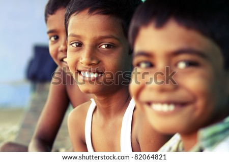 Group of happy teen boys looking at the camera. - stock photo