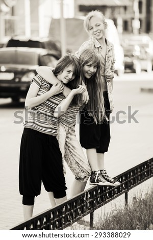 Group of happy teen girls on a city street - stock photo