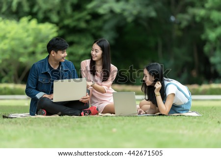 Group of happy teen high school students outdoors - stock photo