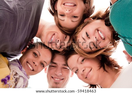 group of happy teenagers in circle �¢���� view from below - stock photo