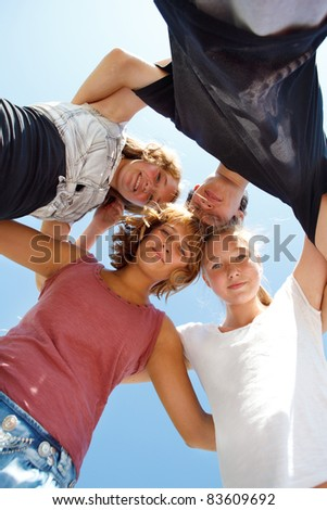 Group of happy teens making a circle - stock photo
