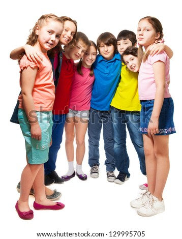 Group of happy 10 years old boys and girls standing together in semi-circle - stock photo