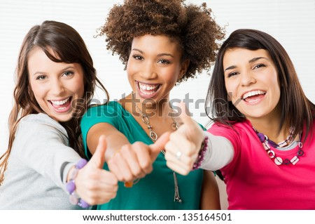 Group Of Happy Young Friends Showing Thumb Up Sign - stock photo