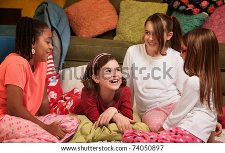 Group of happy young girls at a sleepover - stock photo