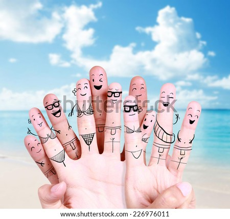 group of happy young people at the beach with drawing finger symbol - stock photo