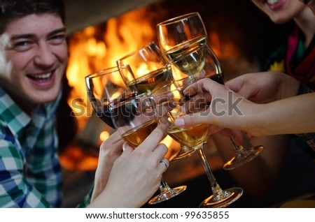 Group of happy young people drink wine  at party disco restaurant - stock photo