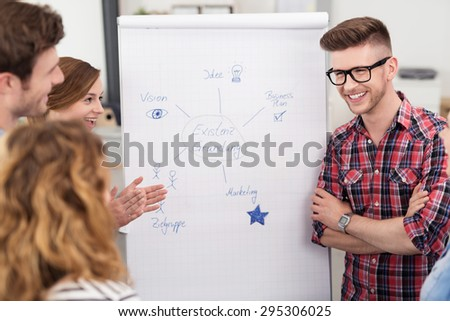 Group of Happy Young People Having a Funny Brainstorming Session About the Business Inside the Office - stock photo