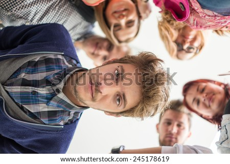 Group of happy young people in circle - stock photo