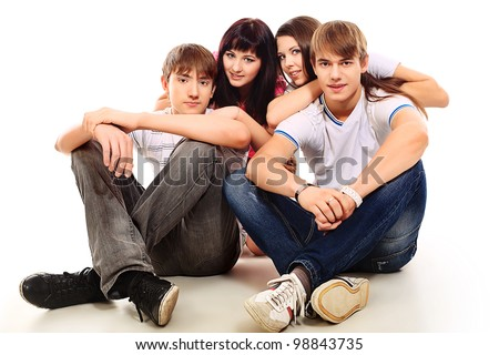 Group of happy young people isolated over white background. - stock photo