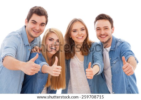 Group of happy young people showing thumbs up, isolated on white background - stock photo