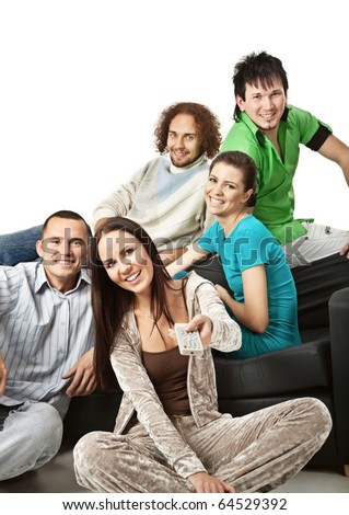 Group of happy young people sitting together and watching TV