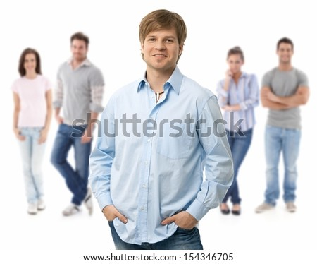 Group of happy young people, smiling man at front, isolated on white background.