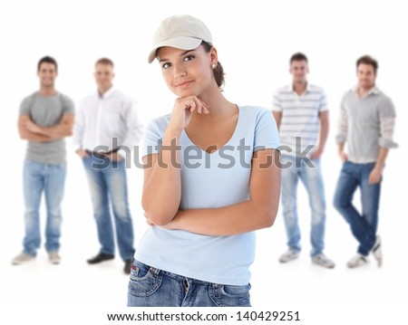 Group of happy young people, smiling woman at front, isolated on white background. - stock photo