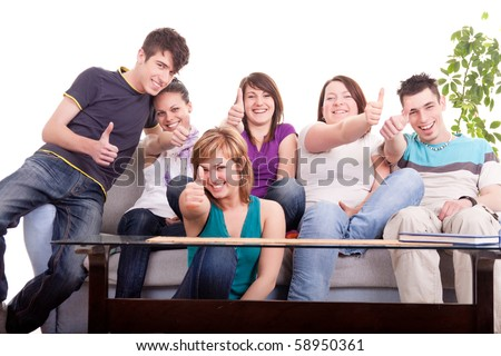 group of happy young teenagers holding thumbs up