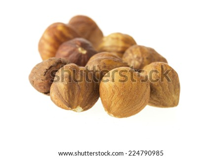 Group of hazelnuts isolated on a white background - stock photo