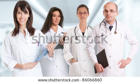 Group of healthcare professionals in a healthcare environment - stock photo