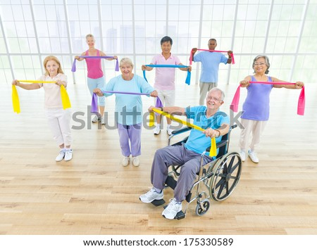 Group of Healthy Mature People and Wheelchair - stock photo