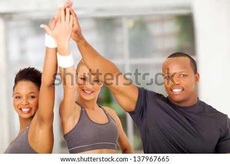 group of healthy people celebrating after exercise - stock photo