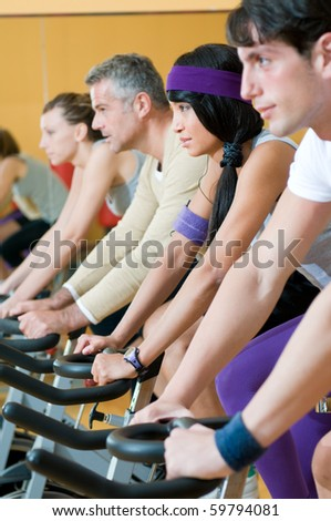 Group of healthy people doing exercise at the gym - stock photo