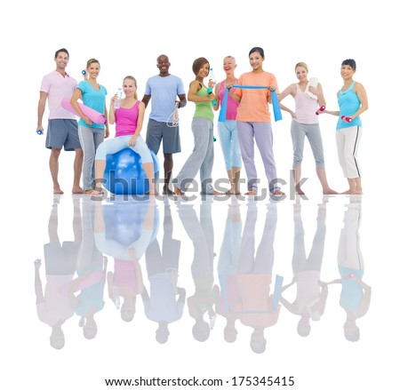 Group of Healthy People Exercising - stock photo