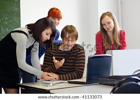 Group Of High School Students Listening To Teacher In Classroom - stock photo