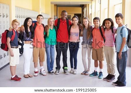 Group Of High School Students Standing In Corridor - stock photo
