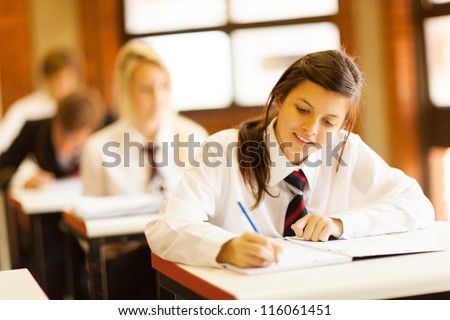 group of high school students studying in classroom - stock photo