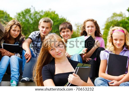 Group of high school students with books in hands - stock photo