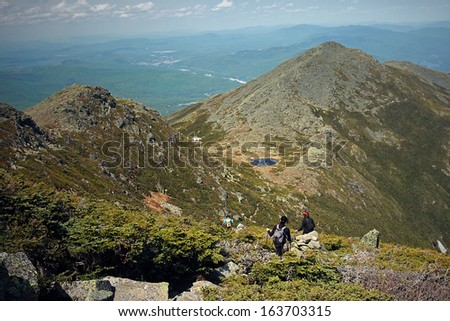 Group of hikers hiking the Star Lake Trail on Mt. Adams in New Hampshire along the appalachian trail. - stock photo