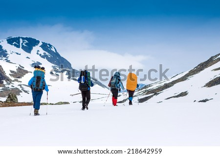 group of hikers in snowy mountains