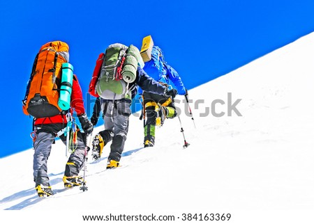 Group of hikers in the mountains. Extreme sport concept - stock photo