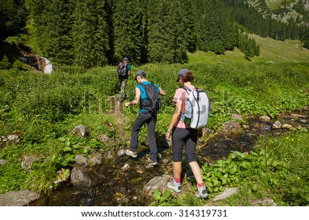 Group of hikers on a trail in the mountains in a beautiful scenery
