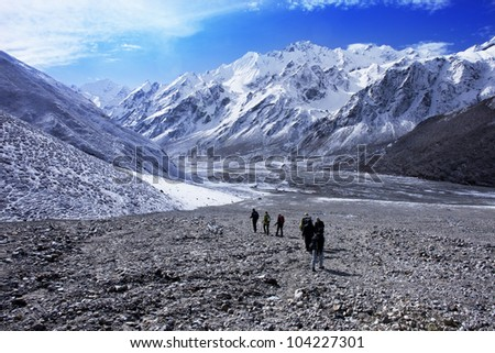 Group of hikers with mountain range, Langtang region, Nepal - stock photo