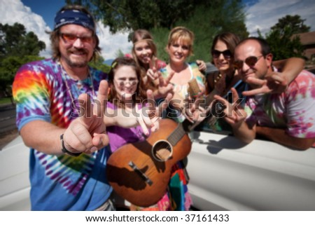 Group of hippies making peace signs - stock photo