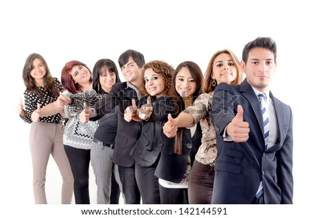 Group of hispanic business people with thumbs up - stock photo