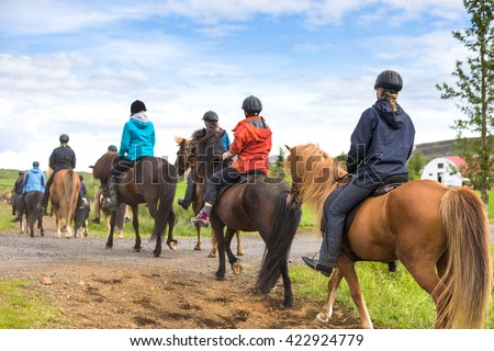 Group of horseback riders in Iceland. Travel beautiful country - stock photo