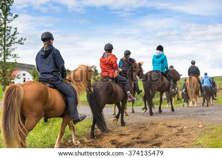 Group of horseback riders ride  in Iceland - stock photo
