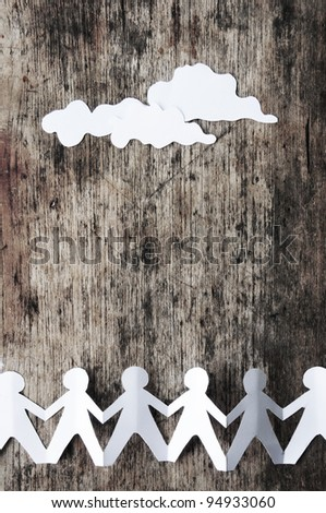 Group of human chain with cloud paper on the wood - stock photo