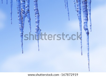 group of icicles against the cold winter sky - stock photo