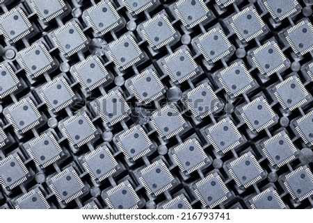 Group of ICs on the tray board - stock photo